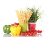 Green onion and spaghetti in cups, paprika and tomatoes cherry isolated on white — Stock Photo