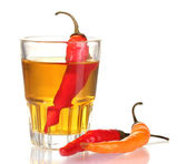 Glass of pepper vodka and red chili peppers isolated on white — Stock Photo