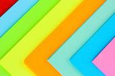 Bakgrund av ljusa färgglada papper — Stockfoto
