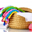 Bright threads for needlework and fabric in a wicker basket — Stock Photo #10585717