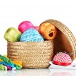 Bright threads for needlework and fabric in a wicker basket — Stock Photo #10585723