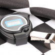 Checkered finish flag with whistle and stopwatch close-up — Stock Photo #10586351