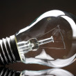 Light bulb on black background — Stock Photo