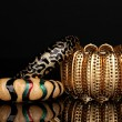 Beautiful golden bracelets isolated on black background - Stock Photo