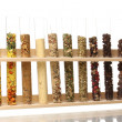Various spices in tubes isolated on white - Foto Stock