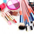 Stock Photo: Make-up brushes in holder and cosmetics isolated on white