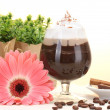 Royalty-Free Stock Photo: Glass of coffee cocktail and gerbera flower on wooden table