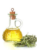 Oil in a bottle and fresh rosemary isolated on white — Stock Photo