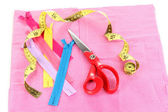 Scissors, zips and measuring tape on fabric isolated on white — Stock Photo