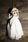 Hanged doll voodoo girl-bride on wooden background — Stock Photo