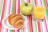 Classical breakfast. Orange juice and croissant — Stock Photo