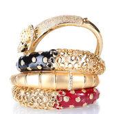 Beautiful golden bracelets isolated on white — Stock Photo