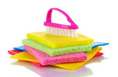 Many colorful sponges and brush for housework isolated on white — Stock Photo