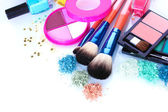 Eye shadow, nail polish and make-up brushes isolated on white — Stock Photo