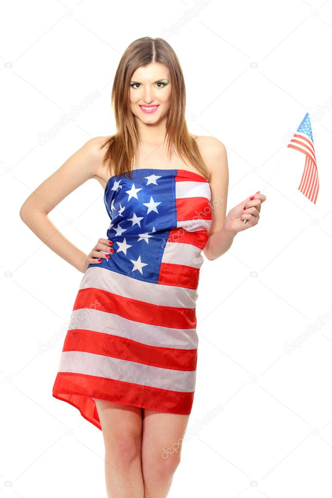 Beautiful young woman wrapped in American flag isolated on white  Stock Photo #10586060