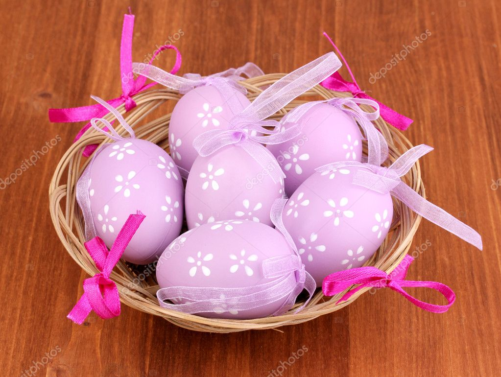 Colorful easter eggs in basket on wooden background  Stock Photo #10586647