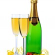 Glasses and bottle of champagne, gifts and serpentine isolated on a white — Stock Photo #10598078