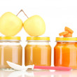 Jar of baby puree with apple, carrot and spoon isolated on white — Stock Photo