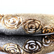 Beautiful golden bracelet on grey background - Lizenzfreies Foto
