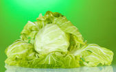 Cabbage on bright green background — Stock Photo