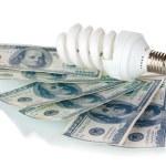 Energy saving lamp and money isolated on white — Stock Photo #10600851