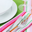 Table setting with fork, knife, plates, and napkin — Stock Photo #10600954