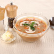 Tasty soup on beige tablecloth - Stock Photo