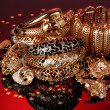 Beautiful golden jewelry on red background - Lizenzfreies Foto