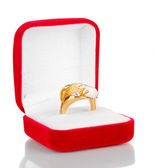 Gold ring with silver pattern and clear crystals in red velvet box isolated on white — Стоковое фото