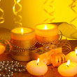 Beautiful candles, gifts and decor on wooden table on yellow background — Stock Photo #10620841