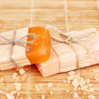 Hand-made natural soaps on wooden mat - Stock Photo