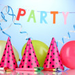Stock Photo: Party items on blue background