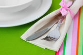 Table setting with fork, knife, plates, and napkin — Stock Photo