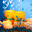 Beautiful candles, gifts and decor on wooden table on blue background — Stock Photo #10646861