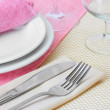 Table setting with fork, knife, plates, and napkin — Stock Photo #10647015