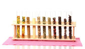 Varias especias en tubos aislados en blanco — Foto de Stock