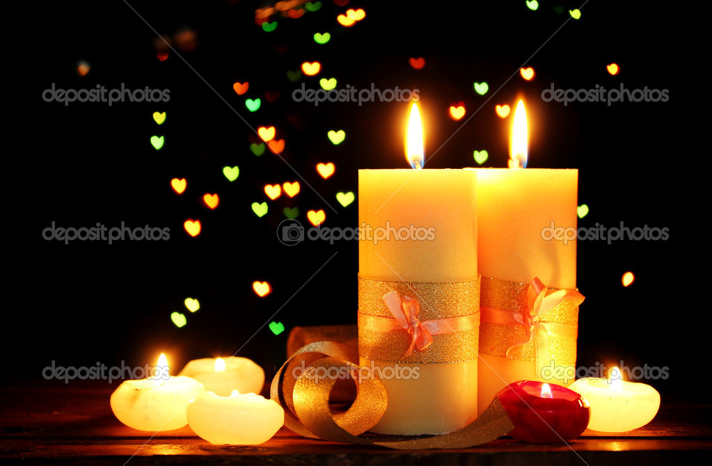 Beautiful candle and decor  on wooden table on bright background — Stock Photo #10646885