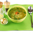 Tasty chicken stock with noodles on green tablecloth — Stock Photo #10653497
