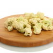 Fresh cauliflower on cutting board isolated on white - Stock Photo