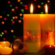 Beautiful candle and decor on wooden table on bright background - Stockfoto