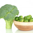Brussels sprouts in wooden bowl and broccoli isolated on white — Stock Photo