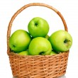 Juicy green apples in the basket isolated on white — Stock Photo