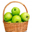 Juicy green apples in the basket isolated on white — Stock Photo #8112946