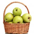 Stock Photo: Juicy green apples in the basket isolated on white