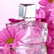 Royalty-Free Stock Photo: Women\'s perfume in beautiful bottle and flowers isolated on white
