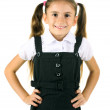 Beautiful little girl in school uniform isolated on white — Stock Photo