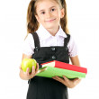 Beautiful little girl in school uniform, books and apple isolated on white — Stock Photo