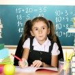 Little schoolchild in classroom near blackboard — Foto de Stock