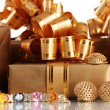 Various gold jewellery and gifts closeup - Stock Photo