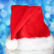 Beautiful Christmas hat on a blue background - Stock Photo